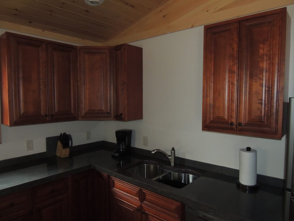 Cabin's kitchen is clean and modern